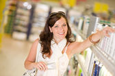 Shopping cosmetics - woman with moisturizer