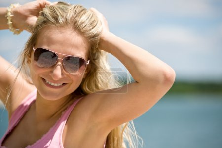 Blond woman with sunglasses enjoy sunny day