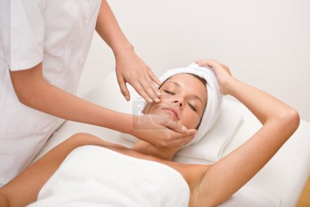 Body care - woman at face massage