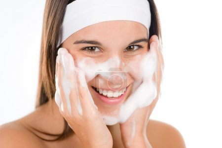 Teenager problem skin care - woman wash face