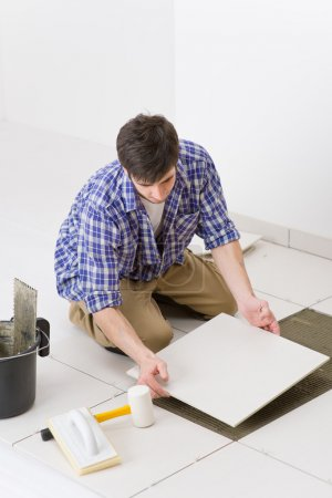 Home improvement - handyman laying tile