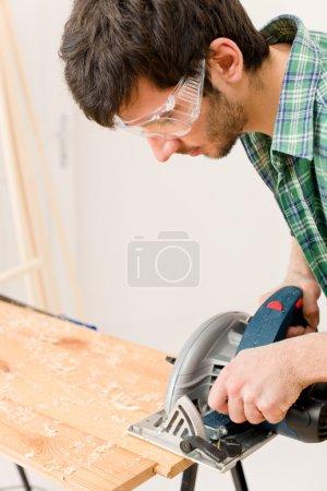 Home improvement - handyman cut wood with jigsaw