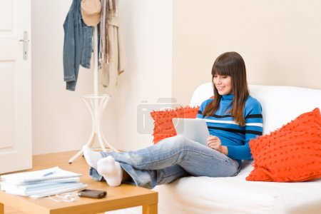Teenager girl relax home with touch screen tablet computer