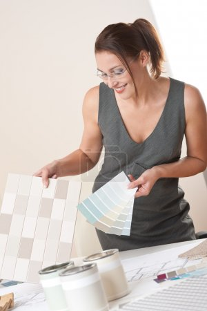 Female interior designer working with color swatch