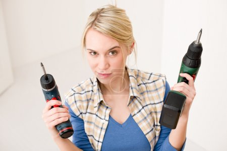 Home improvement - woman with battery screwdriver