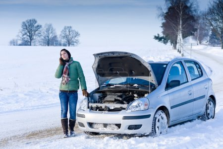 Photo for Winter car breakdown - woman call for help, road assistance - Royalty Free Image