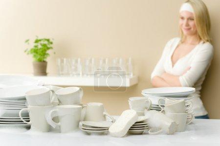 Modern kitchen - happy woman washing dishes