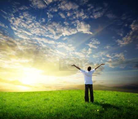 Photo for Field of grass and happy young man - Royalty Free Image