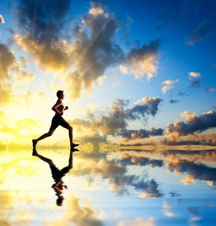 Running man sunset and water