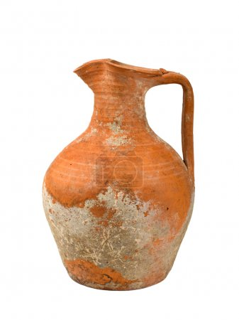 Old pitcher on a white background