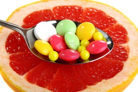 Vitamins on a slice of citrus.