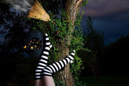 Witch in striped long socks has fallen from her br...