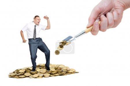 Man dancing on the heap of money