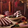 A composition of different sorts of sausages on th...