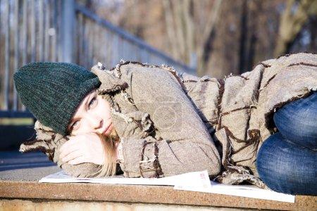 The Woman Lying On Asphalt