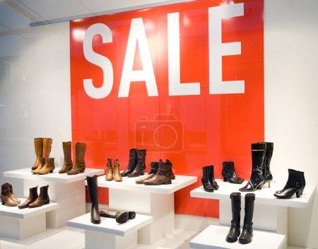 Shoe Store Window In Sale Season