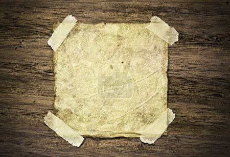 Photo for Old paper on wood background - Royalty Free Image