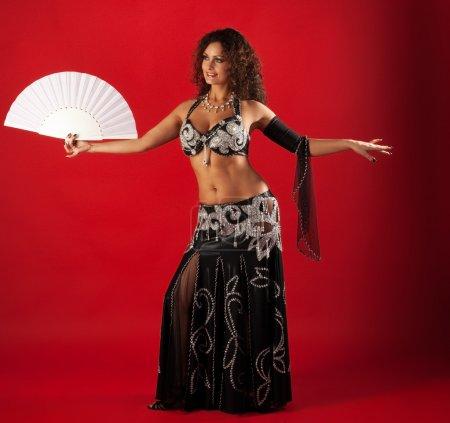 Woman belly dance with fan