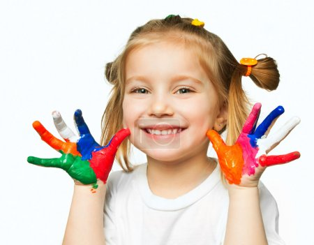 Photo for Beautiful little girl with her ??hands in the paint - Royalty Free Image