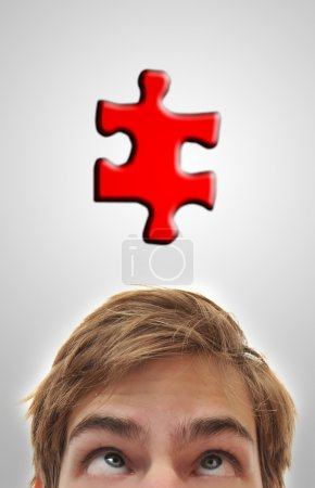 Man looking up at puzzle piece
