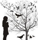 A girl admires the birds