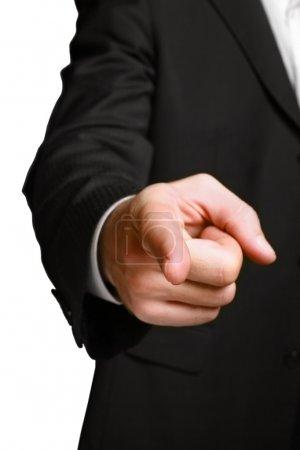 Photo pour Homme d'affaires pointant du doigt le spectateur. Isoler sur blanc . - image libre de droit