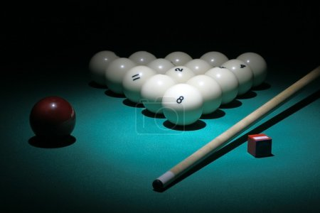 Pool equipment. Balls pyramid with number 8 ball on a foreground