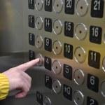 A woman press three button in the elevator