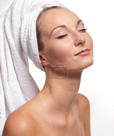 Beautiful girl in the bathtowel