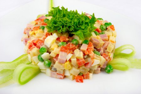 Fresh salad with vegetables, sausage, mayonnaise...