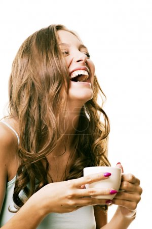 Photo for Beautiful laughing girl with a morning cup of tea in his hands - Royalty Free Image