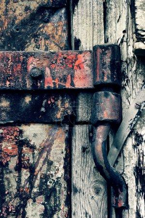 An ancient rusty hinged door
