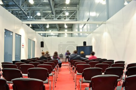 Grey chairs red floor in the Room for presentations