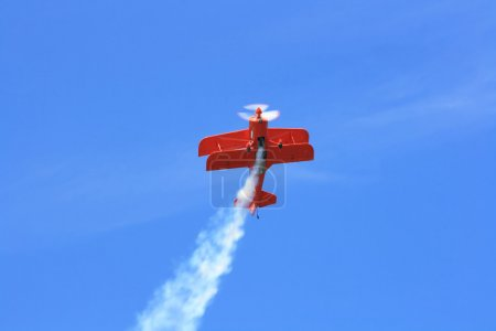 Double-wings sport aeroplane perform demonstrative...