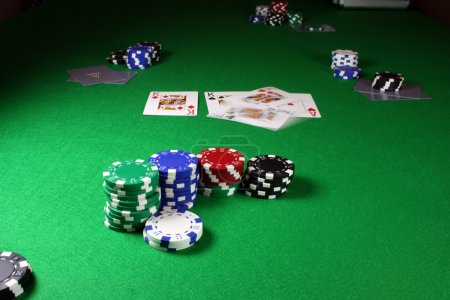 Quad Kings - Action shot on a poker table