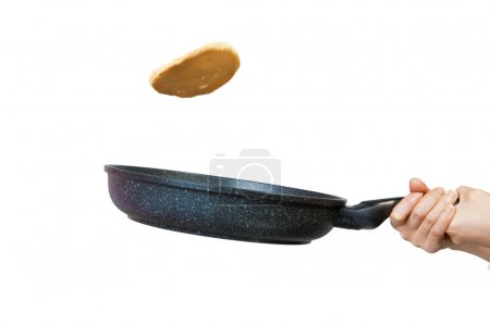 Photo for The process of flipping a pancake in a frying pan against a white background. - Royalty Free Image