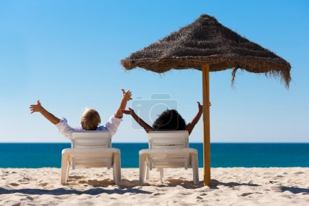 Couple sitting in sun chairs