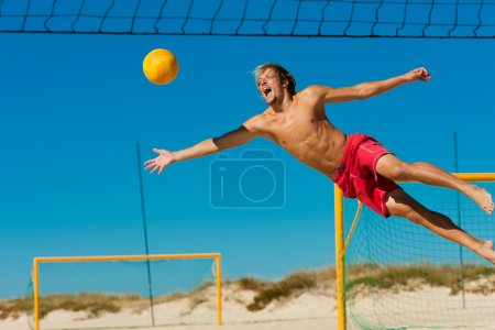 Man playing beach volleyball