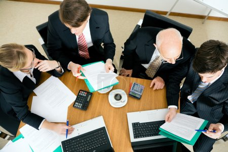 Businesspeople crunching the