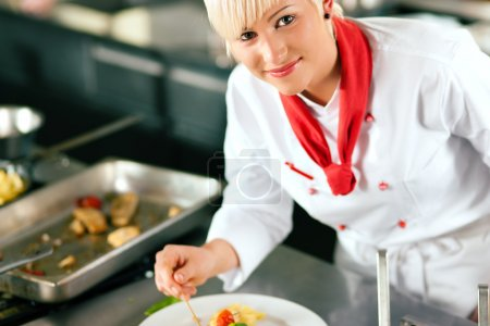 Female Chef in a restaurant or