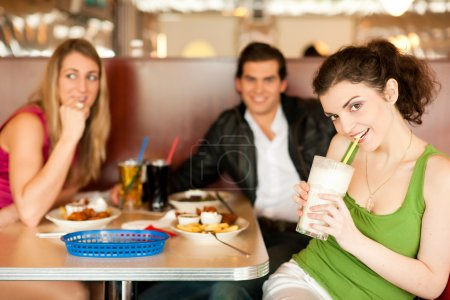 Three friends in a restaurant or