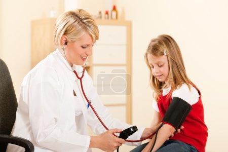 Female doctor measuring blood
