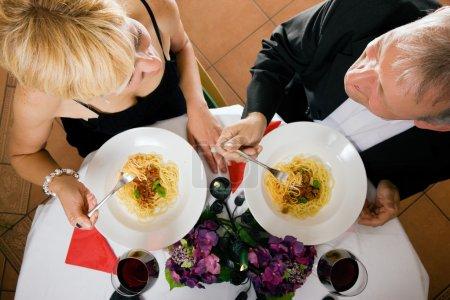 Mature couple eating romantic
