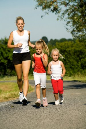 A young mother jogging with