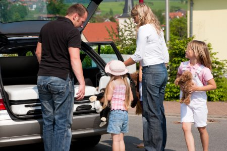 Family travelling by car to their vacation