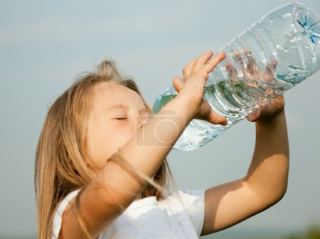 Kid drinking water from a bottle