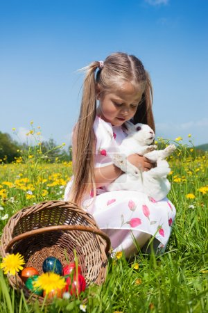 Child petting the Easter bunny