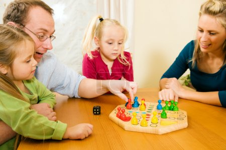 Family playing a board game at