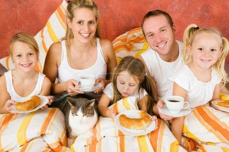 Family having breakfast in their