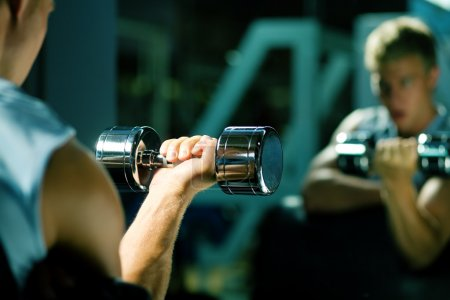 Young with dumbbells, seeing